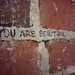 you are beautiful brick wall