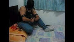 Gagged, hooded and locked in T-shackle (asiancuffs) Tags: prison shackles handcuffs prisoner handcuffed