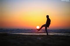 Playing football at Sunset in Gaza. (TeamPalestina) Tags: sunset sky sun sunrise canon landscape landscapes photo am amazing nice nikon photographer natural sweet live palestine comfort sunrays gaza beautifull palestinian  landscapecaptures