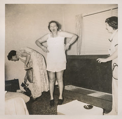 Woman is surprised while changing clothes (simpleinsomnia) Tags: old woman white black monochrome vintage found blackwhite underwear antique snapshot changing photograph vernacular shocked foundphotograph