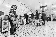 """Kodak Moment"" Piccadilly Circus Underground Station, London, UK (davidgutierrez.co.uk) Tags: city uk greatbritain travel light england people urban blackandwhite bw white man black building london art monochrome beautiful station architecture buildings person photography lights design blackwhite nikon europe cityscape photographer unitedkingdom britain candid interior capital transport tube arts streetphotography structure piccadillycircus londres commuter tubestation londonunderground highkey londra blackandwhitephotography tfl centrallondon  londyn ultrawideangle  cityofwestminster   d810 nikond810 1424mm davidgutierrez londonphotographer afsnikkor1424mmf28ged piccadillycircustubestation davidgutierrezphotography"