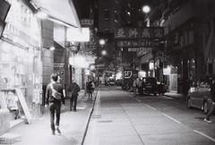 Around The Block (Jon Siegel) Tags: street light people urban blackandwhite bw film night walking hongkong iso3200 evening nikon glow candid adventure 12 nikkor ilford nikonfe2 fe2 50mmf12 nikkor50mmf12ais