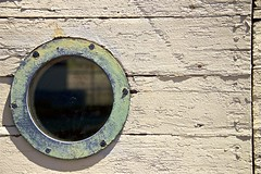 Closer ... (sswj) Tags: weathered porthole window yellow oldbuilding architecturdetail abstractreality boatharbor northerncalifornia scottjohnson composition minimalist nikon d600 nikkor28300mm existinglight naturallight availablelight texture marincounty geometry fullframe dslr raw