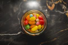 sweeet.... (Pablin79) Tags: light macro argentina colors closeup dof candy flash indoor jar marble jellybean misiones marmol posadas