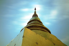 Wat Phra Sing stuppa (pooly7) Tags: longexposure blue sky building tourism yellow architecture clouds thailand temple gold asia outdoor buddhism chiangmai stuppa weldingglass