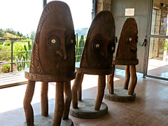 Pirmides de Gmar. Debating chairs with mask motif from Papua New Guinea (Linda DV (away)) Tags: travel geotagged culture canaryislands myth islascanarias controversial gmar 2016 guimar thorheyerdahl geomapped pirmidesdegmar culturaltravel exploretheworld lindadevolder pyramidsofgmar canonpowershotsx40hs