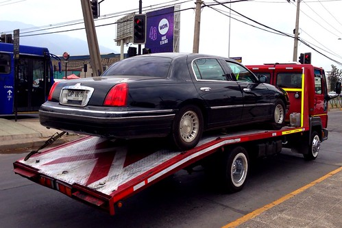Lincoln Town Car On A Ford Flatbed Truck Santiago Chile A Photo