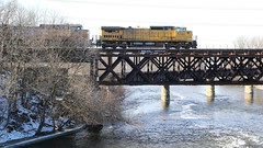 Above the waters (Laurence's Pictures) Tags: railroad bridge chicago water rock electric wisconsin train river pacific general muscle union rail railway line northwestern janesville