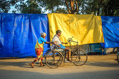 (Mother is Always Carrying) ((NIZHARPADAM)) Tags: blue people yellow mother streetphotography son oldlady care pondicherry roi indianstreetphotography rootsofindia
