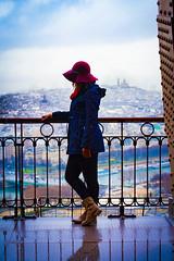 Girl overlooking a rainy Parisian landscape (Afrobandit252) Tags: paris tower girl rain downtown tour eiffel sacre couer effeil