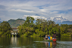 Floating past the Himalayas (gseglenieks) Tags: nepal house mountain color colour nature boat bright cloudy adventure explore jungle pokhara tranquil himalayas