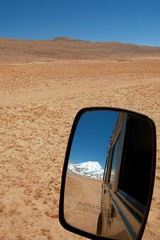 The Cold Desert..... en route to Gurudongmar Lake (pallab seth) Tags: travel blue sky india mountain snow cold tourism nature beauty landscape religious asia tour place desert jeep wind altitude peak buddhism tibet divine stunning hinduism higher sikkim highaltitude northsikkim nikoncoolpixp3 tibetianplateau gurudongmarlake easternhimalayas indianlandscapephotography
