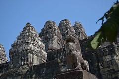 Phnom Bakheng - Singha Guardian and some of the 60 sandstone shrines that adorn the pyramid (Simon5591) Tags: khmer angkorwat siemreap phnombakheng