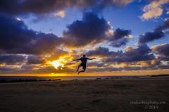 Kickin' It (Ron Harbin Photography) Tags: astoundingimage outerbanks northcarolina killdevilhills jump son blue color outstanding shore jockeysridgestatepark