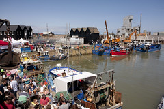 Whitstable harbour (pic by Kent's creative coast) (Neill Barston) Tags: sea summer vacation people holiday fish hot industry tourism festival boats boat kent high fishing break native harbour crane eating tide working drinking sunny tourist tourists gourmet busy shellfish oysters catch dining attract local oyster shelter visitors popular visitor whitstable stay stalls gravel attraction crowded natives cockles whelks bustling
