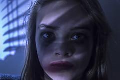 Darkness (Ingleberry2000) Tags: blue light red girl dark hair model pretty shadows dramatic highlights grainy emotional tones chiaroscuro immense tense deadly
