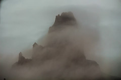 As though Minas Tirith were in Mordor (OpersembeArt) Tags: from road trip arizona usa mist monument rock fog utah us united formation valley mysterious states magical intimidating emerges