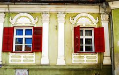 Brasov Window III (PM Kelly) Tags: street old red two green window yellow romania shutter fade crumble brasov