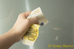200 euros banknote (GemaIbarra1) Tags: people woman white man money businessman closeup female paper person europe commerce hand adult arm euro background bank cash business note human pay giving 200 concept currency isolated hold wealth finance banknote payment