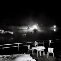whispering (asketoner) Tags: winter light people snow blur ice nature pool night swimming iceland bath darkness chairs silhouettes artificial swimmingpool myvatn