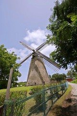 Historic windmill. Barbados. (Emanuele Barcali) Tags: ocean sunset sea vacation sky bw cliff black color green beach water windmill clouds forest sunrise relax island monocromo rocks paradise colours gulf wind withe venezuela wave palm tropical barbados reef bridgetown subtropical volcanic mahogany goodtimes equator carpenter bajan caribbeansea blackwithe northatlanticocean volcanicrocks hillaby mogano barbadosisland