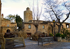 Medieval Pals (angelsgermain) Tags: trees houses winter tower stone square village pals catalonia clocktower catalunya baixempord empordanet