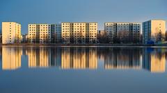1970's perfect symmetry (axial and horizontal) (Janne Herva) Tags: longexposure building water river evening spring dusk vesi ilta rakennus joki kevt kerrostalo culturelandscape pitkvaloitusaika rakennettuymprist apartmethouse