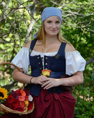 Pirate flower seller at the faire (albionphoto) Tags: woman usa ny girl cosplay parrot dancer fairy tuxedo blonde robinhood renaissancefair flowerseller pirategirl sterlingforest girlswithswords vixensengarde