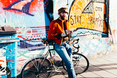 Bristol; January 2016 (Daniel Durrans) Tags: street shadow urban streetart man hat bike bicycle bristol beard graffiti streetphotography graffitiart stokescroft militaryjacket stayhappy