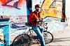 Bristol; January 2016 (Daniel Durrans) Tags: street shadow urban streetart man hat bike bicycle bristol beard graffiti streetphotography graffitiart stokescroft militaryjacket stayhappy