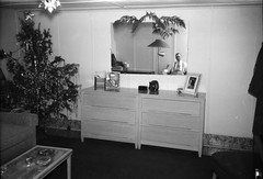 Man sitting in front of a mirror on Christmas (simpleinsomnia) Tags: christmas old white man black reflection tree monochrome vintage found mirror blackwhite antique snapshot tie christmastree photograph vernacular foundphotograph