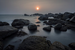 Sunset at Kanyakumari (Ravikanth K) Tags: ocean longexposure light sunset shadow sea sunlight seascape motion color reflection beach water landscape still rocks waves glow outdoor fineart peaceful calm formation southern boulders tip cape serene kanyakumari kanniyakumari comorin 500px nikond750