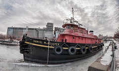 Daniel McAllister Tugboat - Old Port of Montreal (Steve Troletti Nature & Wildlife Photographer) Tags: old winter red white canada black history ice water clouds river ir boat chains nikon spectrum quebec montreal grain silo full fisheye historical tugboat nikkor roaps