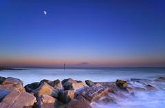 Blue Hour Moon [Explored] (Langstone Joe) Tags: longexposure sunset moon seascape coast rocks haylingisland hampshire coastal bluehour sandypoint