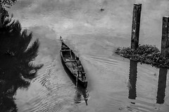 At Thevera, The Sandman Goes Home (Anoop Negi) Tags: india white black water monochrome reflections photography boat photo working kerala sandman cochin anoop bnw backwaters ernakulam negi thevera ezee123 thavera