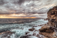 Even the sun's wary of the angry sea (JustAddVignette) Tags: ocean morning light sea sky cliff sun seascape beach water rain clouds sunrise reflections dawn landscapes early rocks waves sydney australia spray newsouthwales nosun seawater brontebeach angrysea easternsuburbs