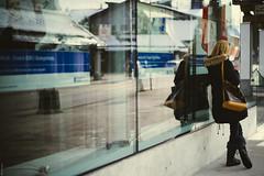 Typing (donlunzo16) Tags: street city woman color film window girl reflections lens schweiz switzerland town nikon df raw nef swiss bank pack filter nd nikkor 58mm vignette afs lightroom 2x lenzerheide valbella f114 preset vsco