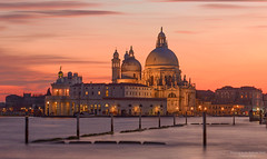 Santa Maria Della Salute (Aubrey Stoll) Tags: longexposure venice windows sunset tourism church water architecture boats lights sticks basilica religion romantic visitors posts domes peninsula gondolas dorsoduro itally dosoduro