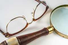 Horn-Rimmed Eyeglasses And Magnifying Glass (AudioClassic) Tags: white macro looking magnifyingglass equipment whitebackground transparent eyeglasses exploration ideas onwhite discovery isolated searching concepts magnification hornrimmed singleobject analyzing glassmaterial opticalinstrument focusconcept lensopticalinstrument