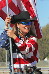 Flag Bearer (wyojones) Tags: horse woman cute girl beautiful beauty hat sunglasses pretty texas flag houston shades parade jacket blonde cowgirl lovely cowboyhat starsandstripes saddle usflag trailride oldglory houstonlivestockshowandrodeo cowgirlhat saddlehorn wyojones houstonlivestockandrodeoparade