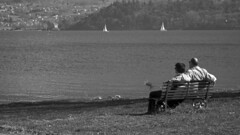 Thinking (Diego Innocenti) Tags: old people blackandwhite bw italy white lake black como love bench boats see boat blackwhite couple italia village seeing persons comolake lagodicomo valtellina hs20 domaso hs20exr
