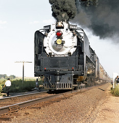 Union Pacific FEF-3 class 4-8-4 Northern steam locomotive # 8444, is seen leading a rail fan excursion train along the main line on a photo run-by in Colorado, Summer 1980 - 3 (alcomike43) Tags: old people color classic up modern vintage ties photo colorado tracks trails trains historic passengers negative photograph engines unionpacific northern spikes steamengine locomotives observers railroads onlookers ballast rightofway steamlocomotive 484 alco mainline oilburner passengertrains roadbed railfans 8444 tieplates anglebars conventionaljointedsectionrail railfanexcursiontrains fef3class