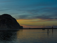 Paddleboarding Along Morro Bay (Basak Prince Photography) Tags: california sunset seascape silhouette night peaceful serene morrobay watersports centralcoast morrorock paddleboard shadws paddleboarding