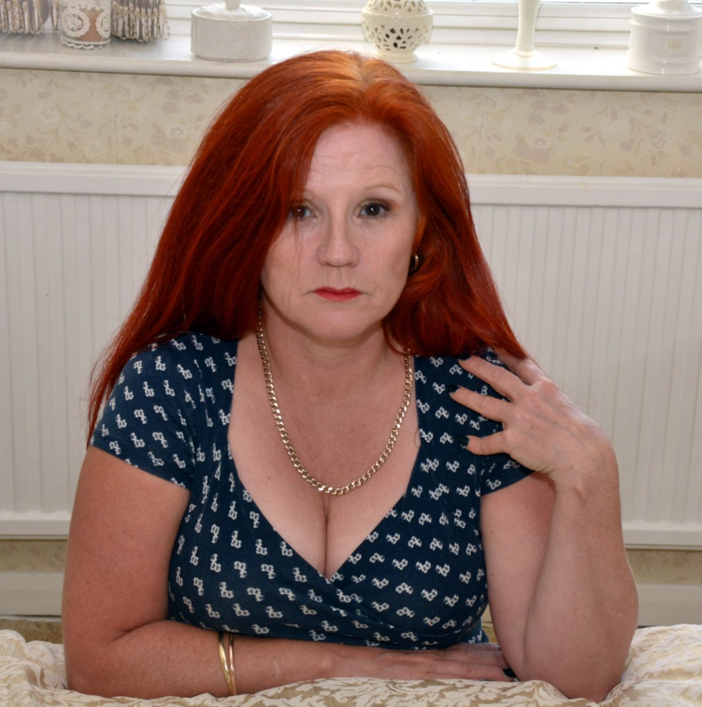 Mature redhead boobs
