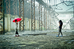 Heavy rain and Photographer (Lanze.H) Tags: travel red sun white abandoned girl rain weather architecture clouds zeiss umbrella model mine factory arch photographer shots explore photograph abandon capture raining exploration carlzeiss a6000 sel1670z