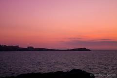 Pink skies (bindysmith) Tags: ocean pink sunset england sky seascape skyline canon landscape island evening bay spring cornwall sundown dusk horizon newquay porth coastline distance headland kernow eos1100d