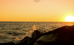 Splash (Fredrik Lindedal) Tags: ocean light sunset orange sun sunlight seascape water colors yellow landscape island spain nikon rocks wave canary splash isle warmlight onewithnature lindedal