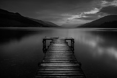 Loch Earn (Andrew Paul Watson) Tags: sunset shadow blackandwhite lake mountains monochrome clouds scotland pier wooden highlands skies scottish explore loch shape earn andrewpaulwatson