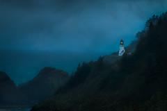 Storm at Heceta Head (GeorgeOfTheGorge) Tags: ocean blue light cliff lighthouse oregon dark coast march us florence rocks moody unitedstates pacific foggy stormy illuminated gloom pacificcoast envelop copyrighted hecetahead darkandstormy colorphotograph explored