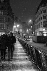 This is England (mecenas zielon) Tags: city england people blackandwhite bw snow weather night walking manchester fun outside 50mm couple streetphotography passing myplace allforfun